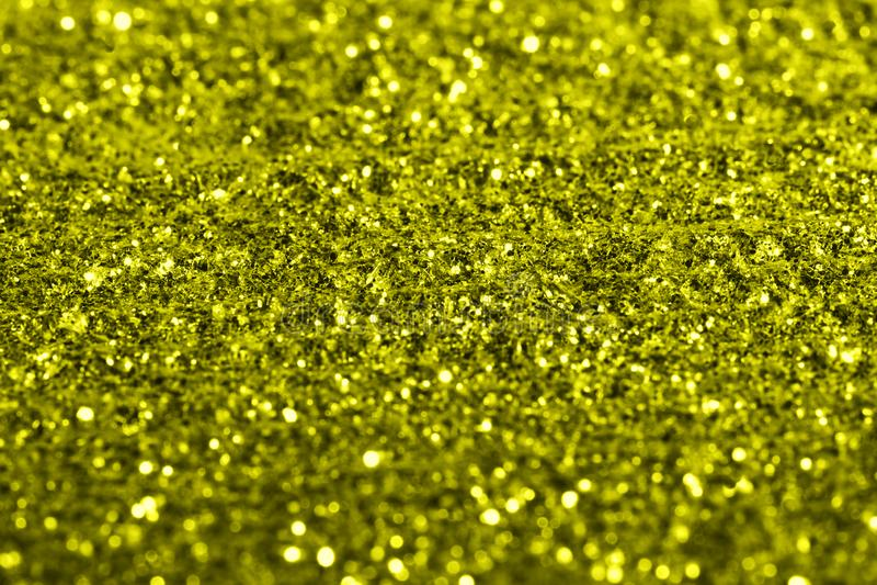 Golden giltter texture festive abstract background, workpiece for design, soft focus stock photo