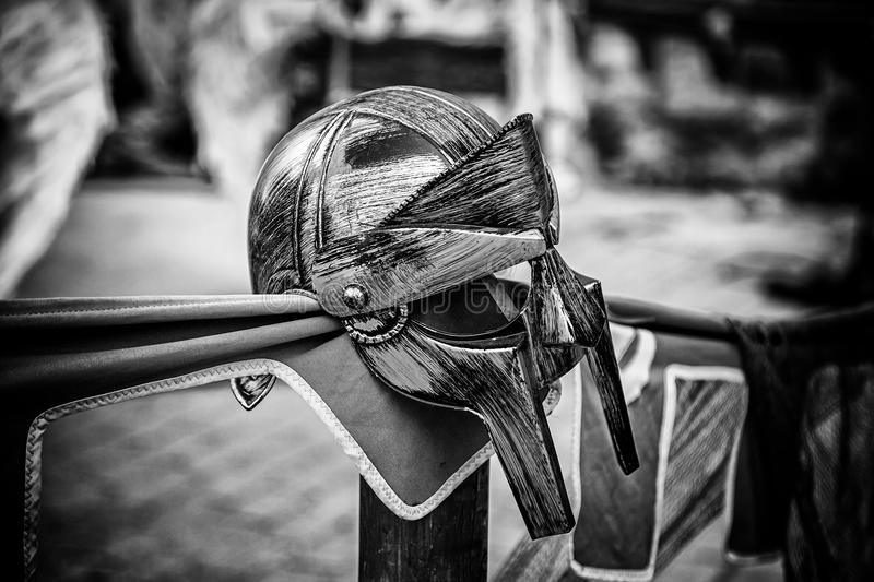 Golden gladiator helmet for protection in combat and war. Detail of protection and security in Spain royalty free stock photography