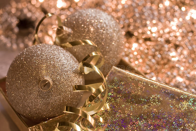 Golden glass spheres in Christmas bright backgroun stock images