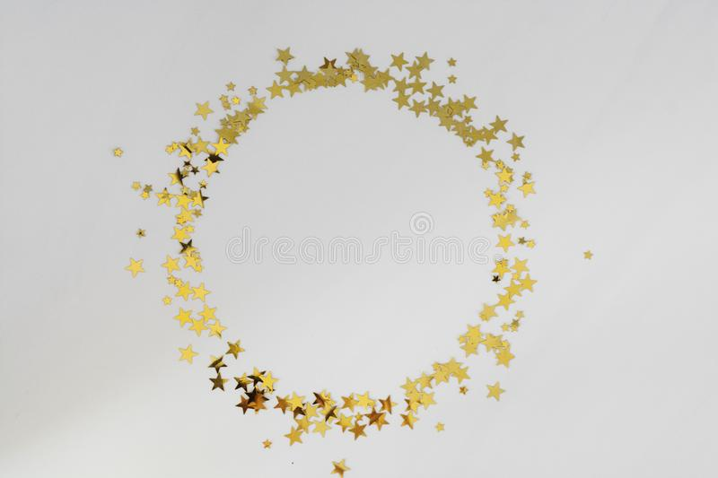 Golden glitter frame circle, confetti stars isolated on white background. Christmas, party or birthday background stock images