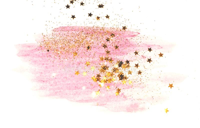 Golden glitter and glittering stars on abstract pink watercolor splash on white background. For your design stock photo