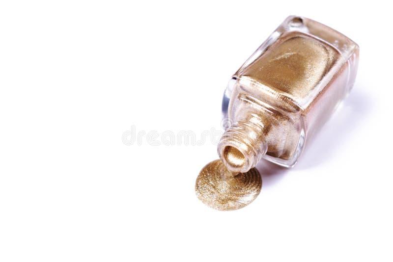 Golden glitter nail polish isolated on white. royalty free stock photos