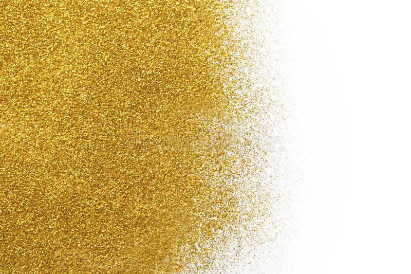 Golden glitter sand texture on white, abstract background. Golden glitter sand texture spread on white, abstract background with copy space. Yellow dusty royalty free stock images