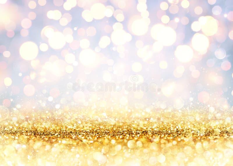 Golden Glitter On Shiny backdrop stock photography