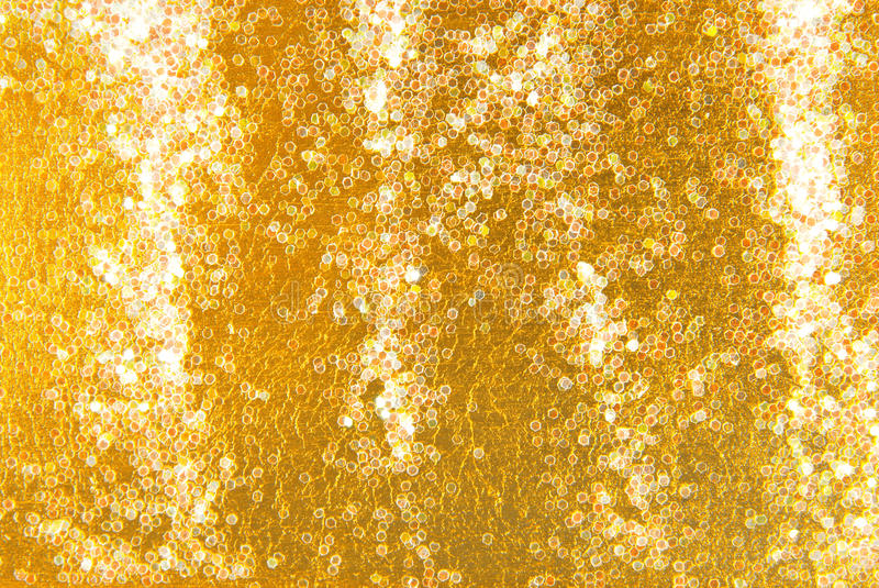 Golden glitter sparkle background stock photography