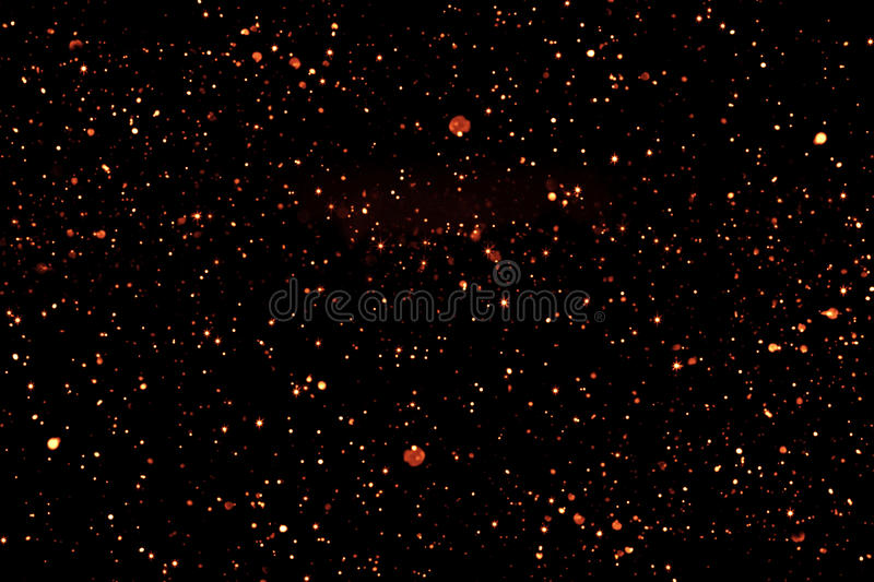 Golden glitter sparkle bubbles particles bokeh on black background, event festive happy new year holiday. Concept royalty free stock image