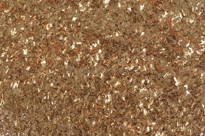 Golden glitter texture, abstract background. Bright exclusive texture, pattern. Low contrast photo. stock images