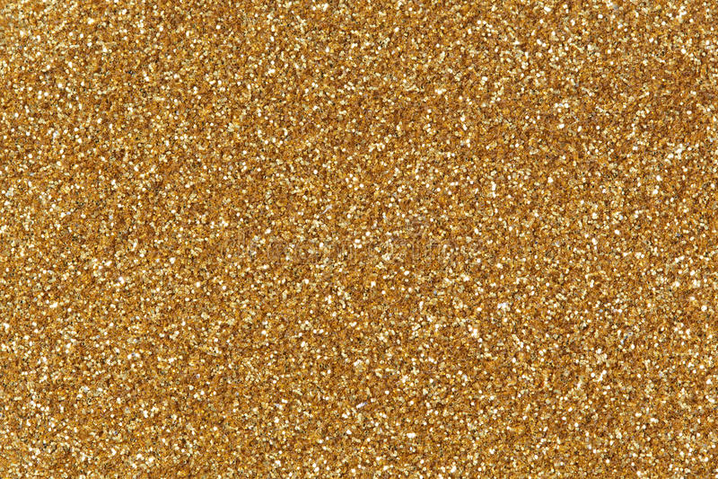 Golden glitter texture christmas background. royalty free stock image