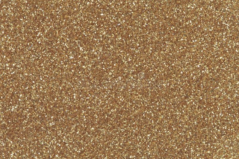 Golden glitter texture christmas background. Low contrast photo royalty free stock image