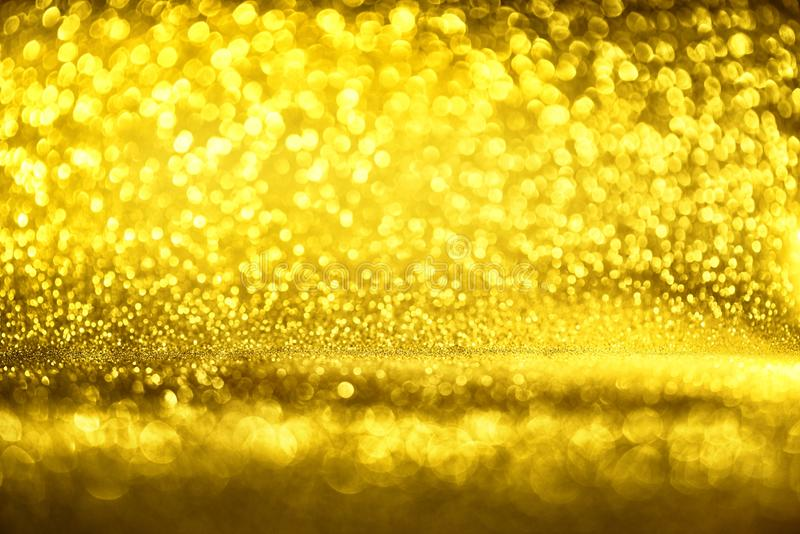 Golden glitter texture Colorfull Blurred abstract background for birthday, anniversary, wedding, new year eve or Christmas.  royalty free stock image