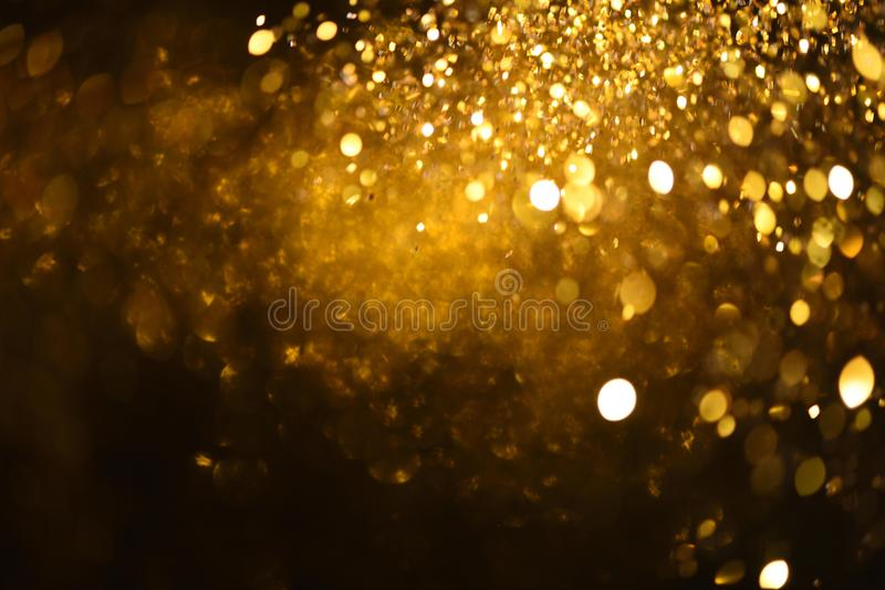 Golden glitter texture Colorfull Blurred abstract background for birthday, anniversary, wedding, new year eve or Christmas.  stock image