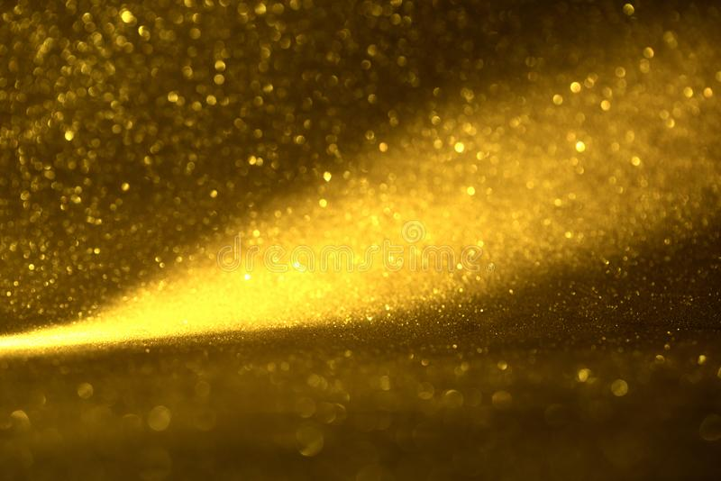 Golden glitter texture Colorfull Blurred abstract background for birthday, anniversary, wedding, new year eve or Christmas.  royalty free stock images