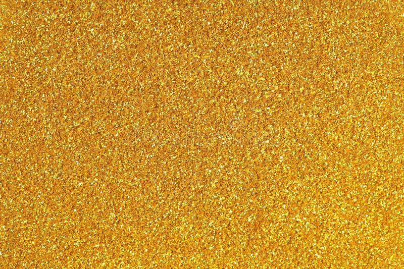 Golden glitter texture. High quality texture in extremely high resolution. stock image