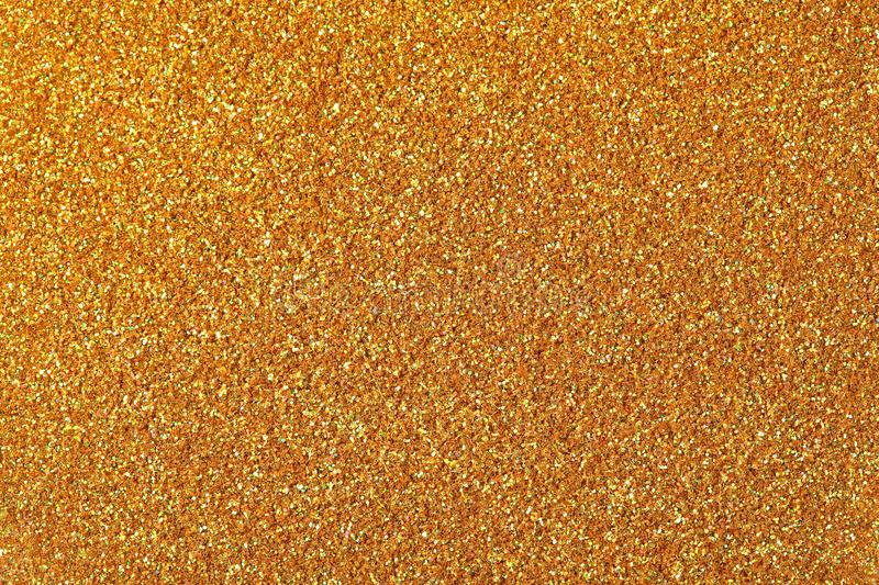 Golden glitter texture. High resolution photo of golgen glitter background. stock images