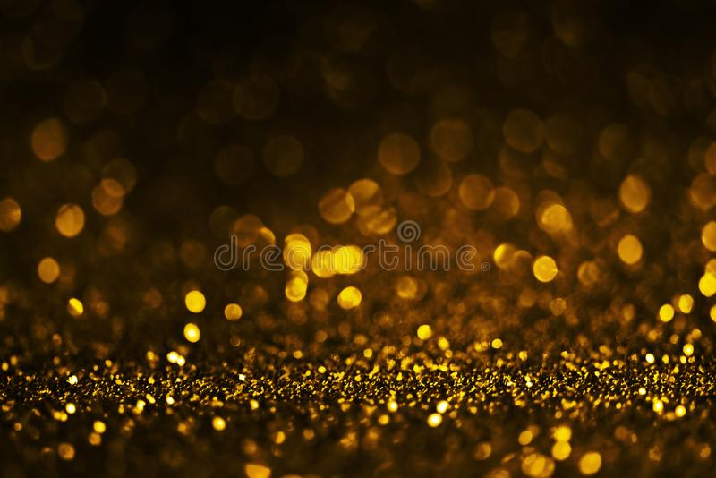 Golden glitter textured background for christmas and new year celebration party royalty free stock photo