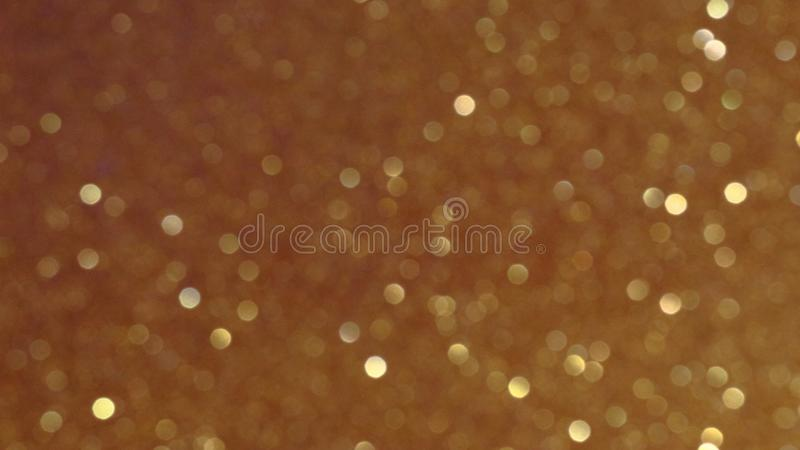 Golden glittering background, bokeh effect using defocused mode. With copy space for insert text stock photo