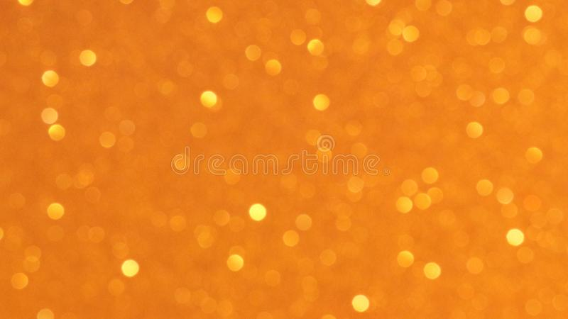 Golden glittering background, bokeh effect using defocused mode. With copy space for insert text royalty free stock images