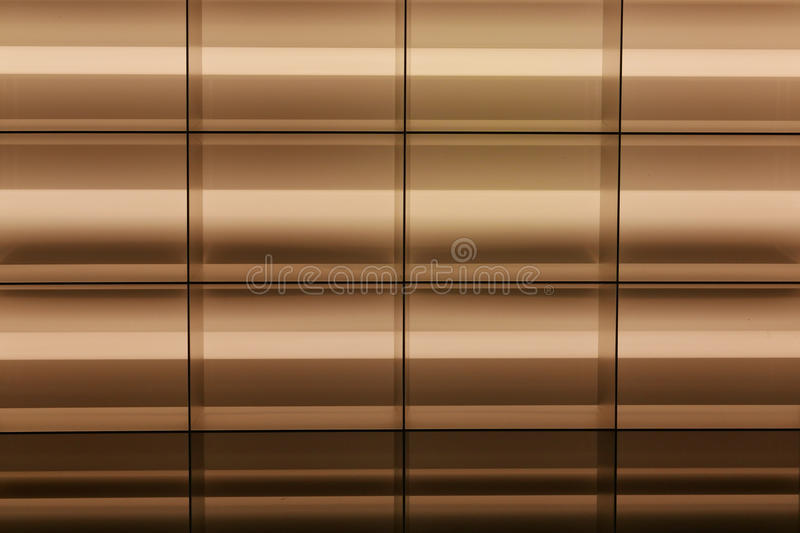 Golden Grid Background. Fluorescent lights closeup create golden bronze background with black grid and horizontal lines stock image