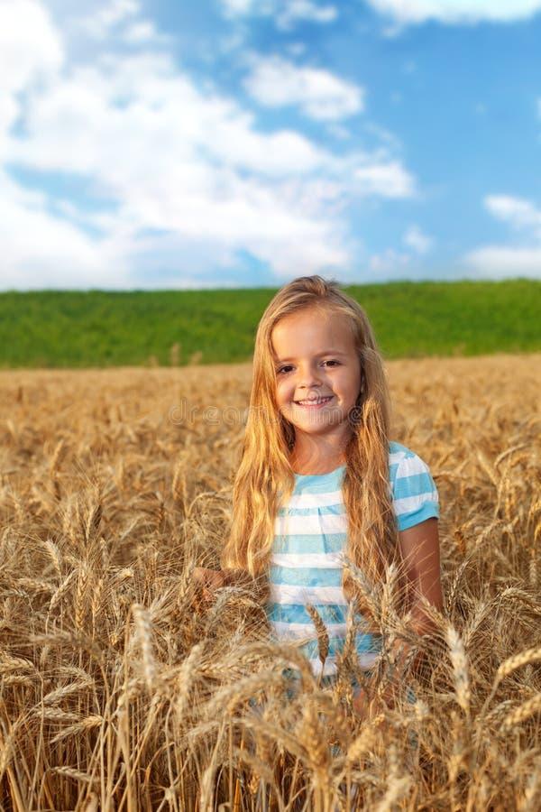 Golden Hair Girl On Wheat Field Stock Images
