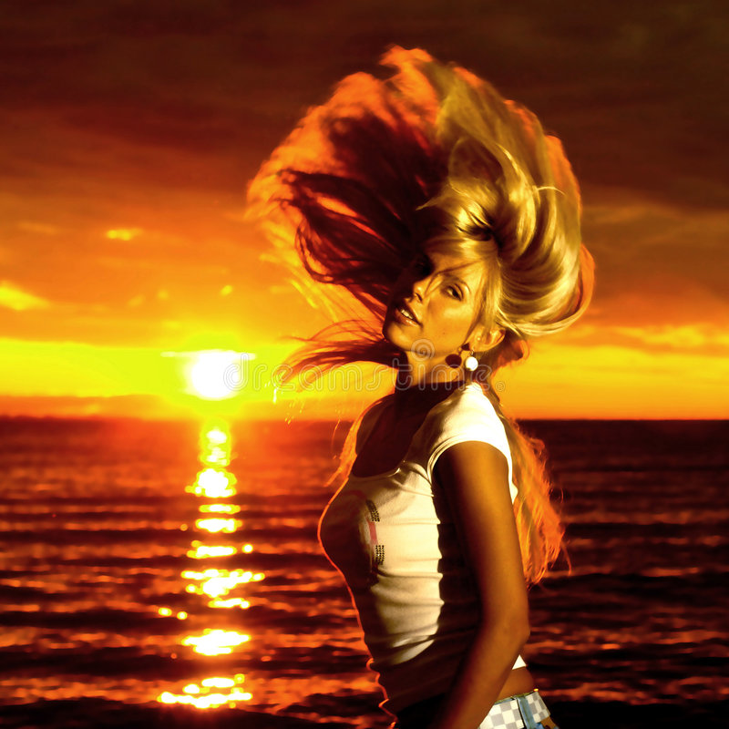 Golden hair motion. Beautiful girl hair motion on golden sunset royalty free stock photo