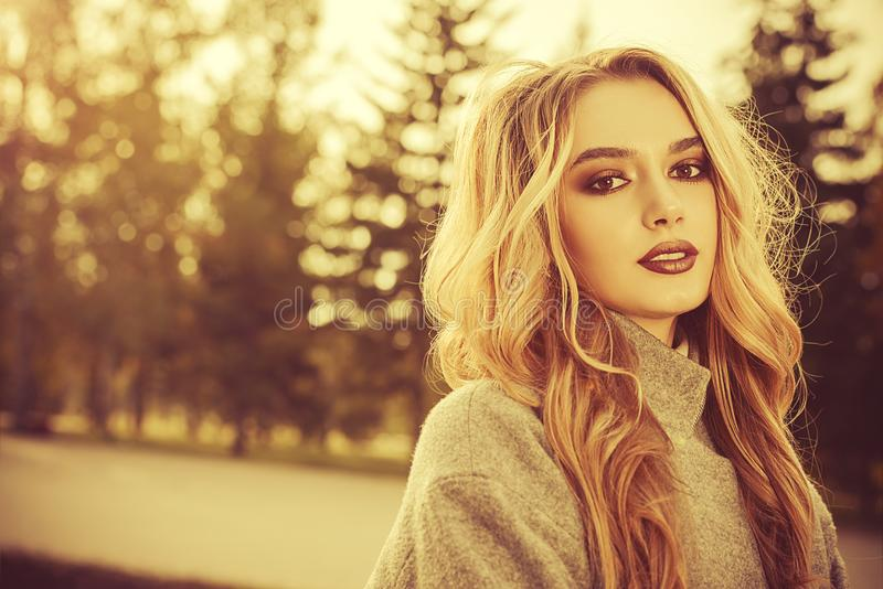 Golden-haired autumn girl royalty free stock images
