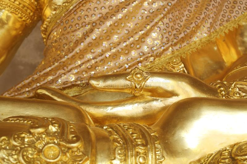 Golden hand of image Buddha close up royalty free stock photography