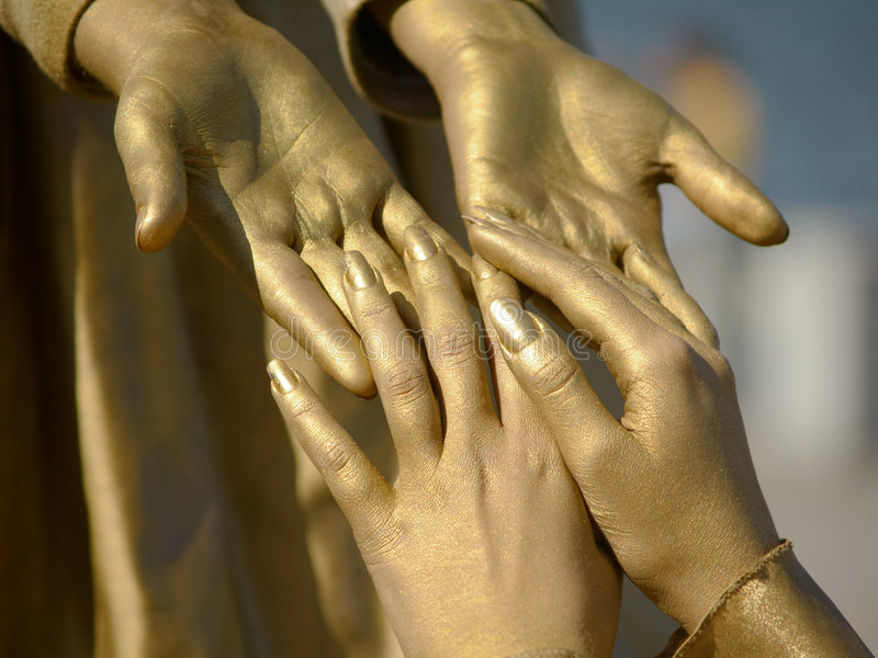 Golden hands royalty free stock image