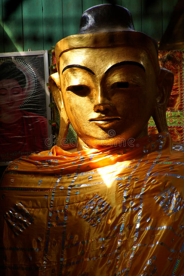 Golden head of Buddha stock photography