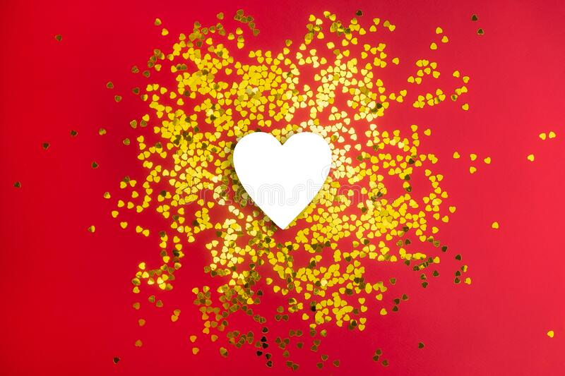 Golden hearts glitter frame on red background. Valentine, love, wedding, marriage concept.  royalty free stock image
