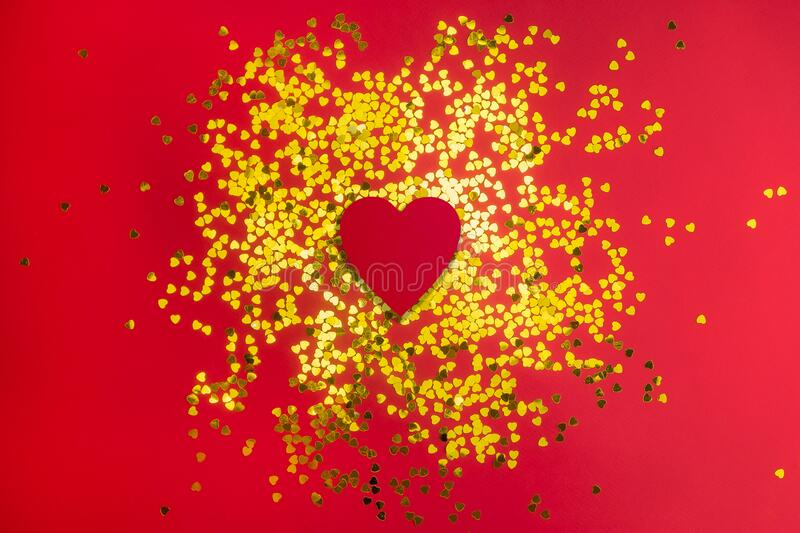 Golden hearts glitter frame on red background. Valentine, love, wedding, marriage concept.  royalty free stock images