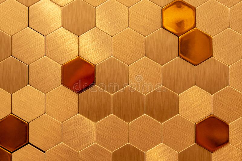 Golden hexagon cell tiling on the luxury decoration interior Gold metal honeycomb, hexagon, abstract metal background royalty free stock image