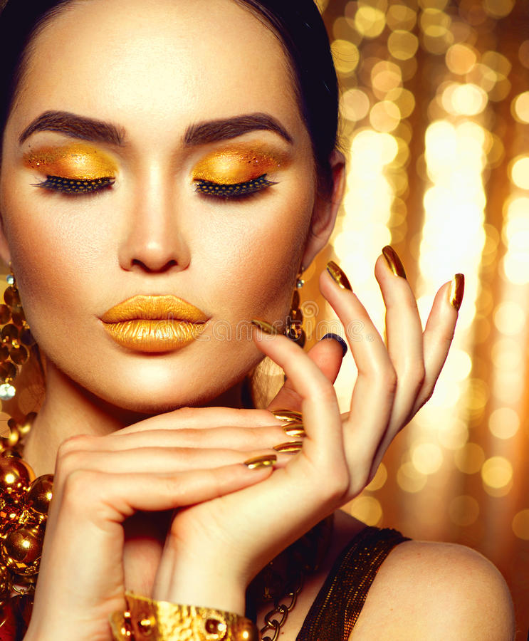 Golden holiday makeup. Fashion art manicure and makeup stock image