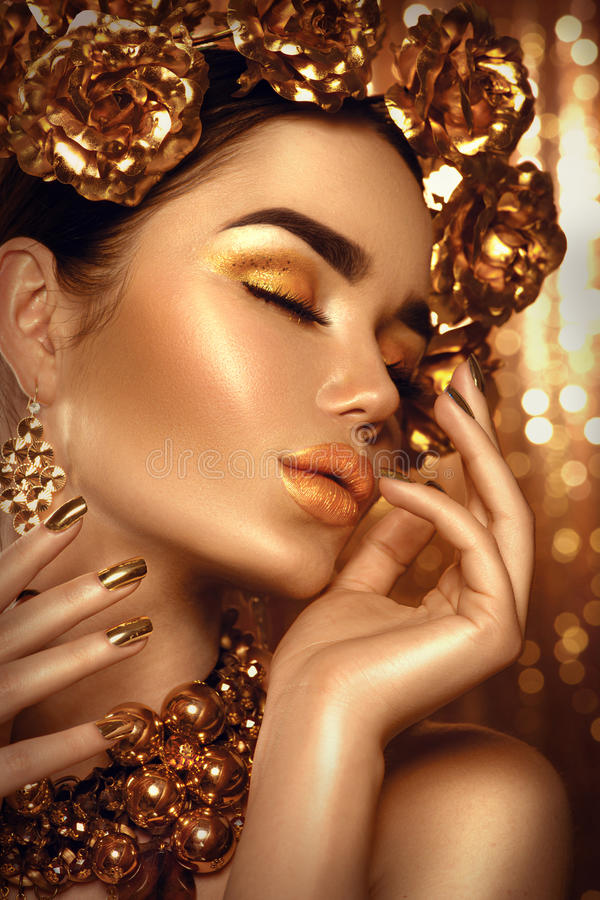 Golden holiday makeup. Golden wreath and necklace stock image