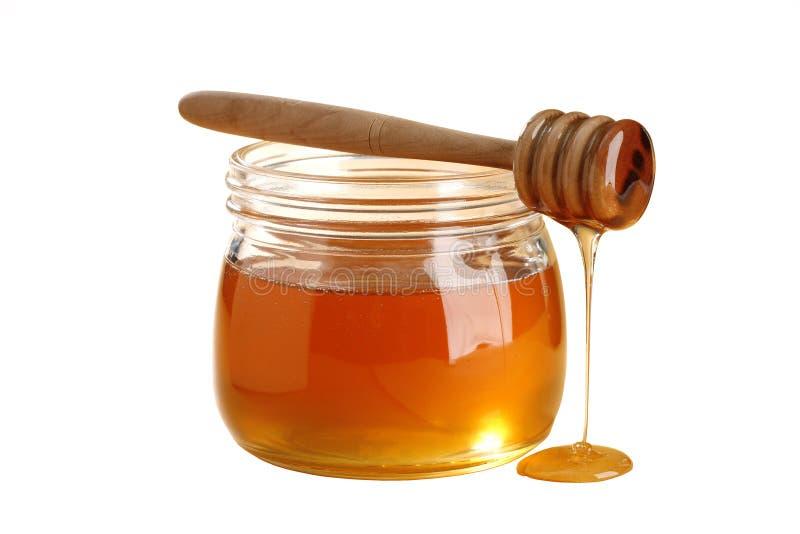 Golden honey isolated on white background stock photo