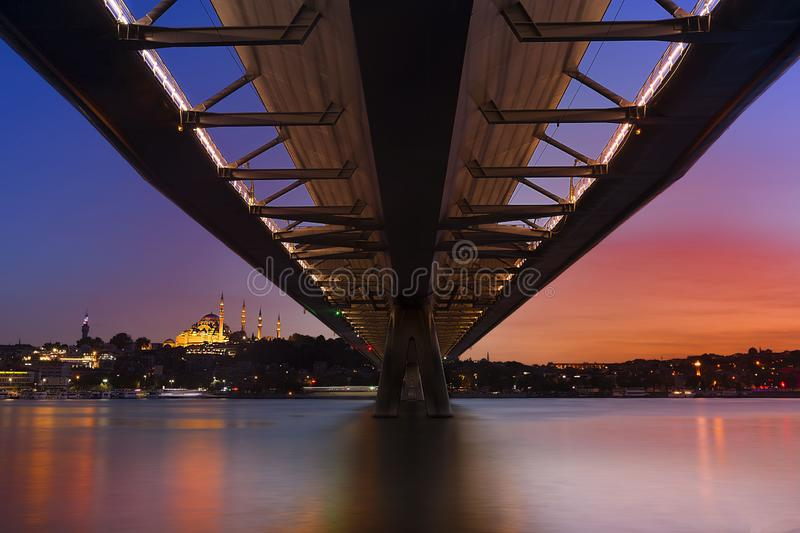 Halic Metro Bridge and Galata Tower on the background, view from the Golden Horn, Istanbul, Turkey. royalty free stock photo