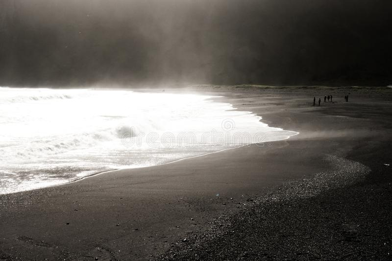 The golden hour on a black sand beach stock images