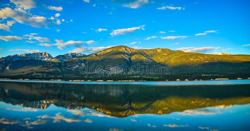 Golden Hour Columbia Lake Reflection, British Columbia, Canada royalty free stock images