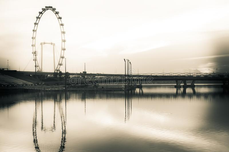 Golden Hour and the Singapore Flyer. The start of the golden hour in the morning with the Singapore Flyer royalty free stock image