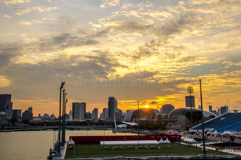 Singapore - AUGUST 3, 2016: A golden hour sunset view of the esplanade and the cityscape. A golden hour sunset view of the esplanade and the cityscape royalty free stock photos