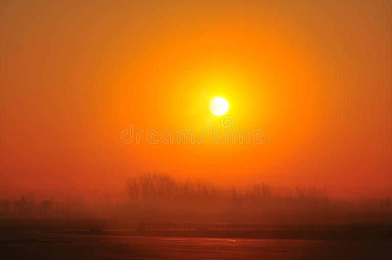 Golden hour tranquil sunrise. Beautiful and tranquil sunrise on a foggy winter day in jinan, china stock photo