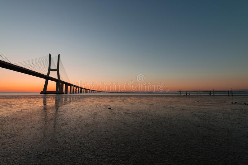Golden hour at Vasco de Gama Bridge in Lisbon. Ponte Vasco de Gama, Lisboa, Portugal. Peaceful atmosphere at Vasco de Gama Bridge in Lisbon during sunrise. Ponte royalty free stock images