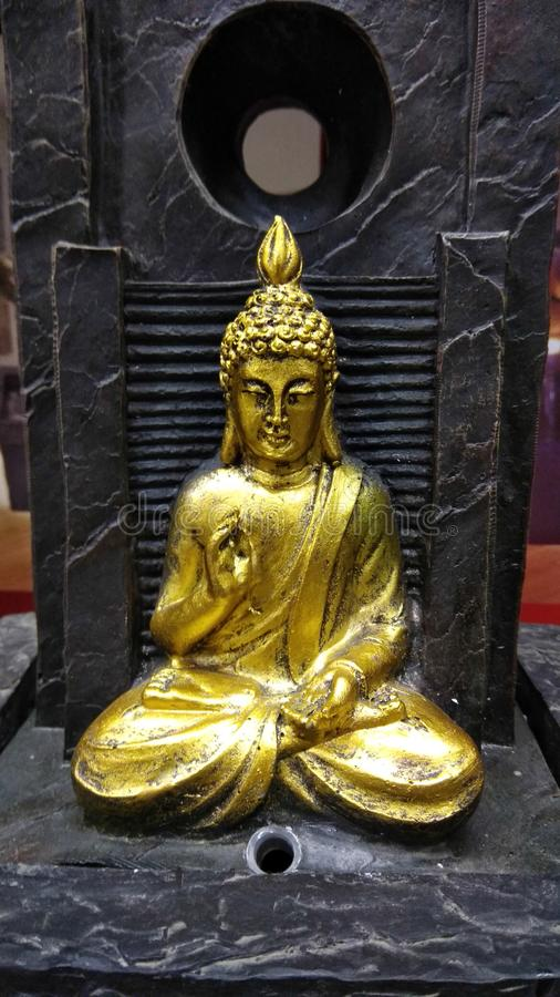Gold idol of Buddha. Golden idol of lord buddha, meditation pose, small in size for indoor collection, beautiful sfigurine of Budhha stock photo