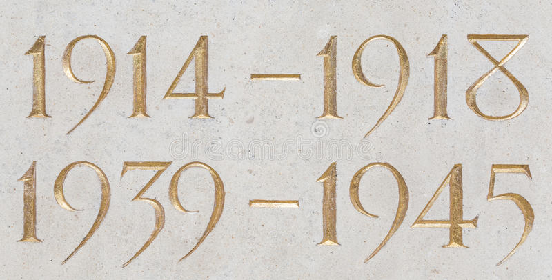 Golden inscription of the years of the two world wars royalty free stock photos