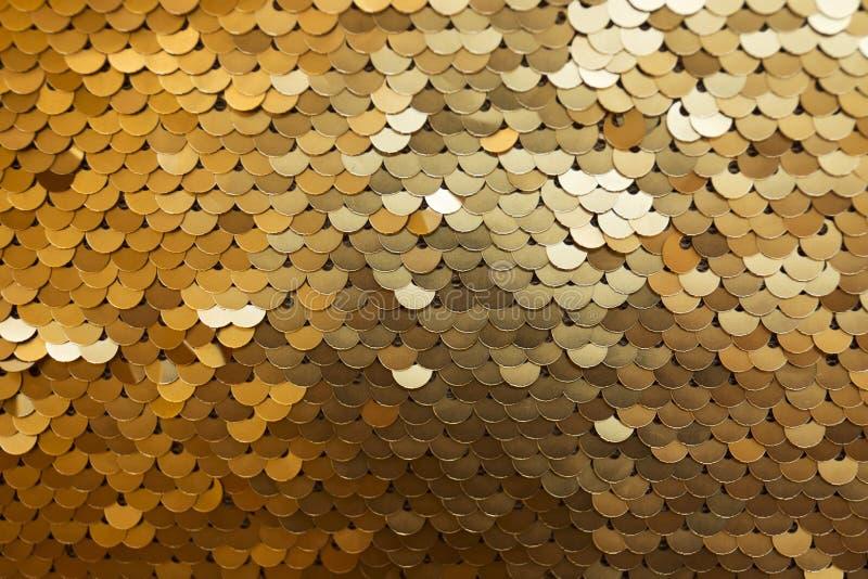 Golden and iridescent sequins texture background stock photo