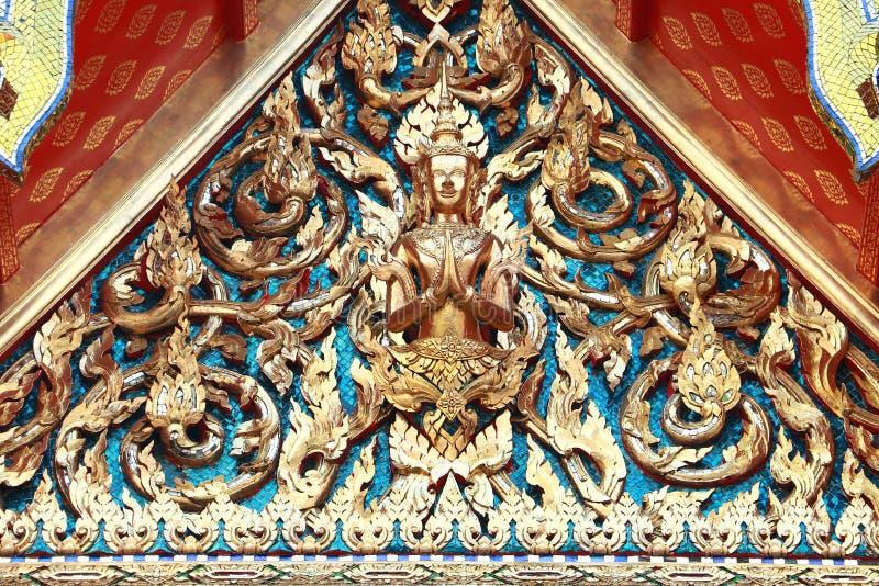Golden isosceles structure on Thai Temple Roof of Wat Pho Temple, Bangkok, Thailand. Golden isosceles structure on Thai Temple Roof of Wat Phra Chetuphon stock photo