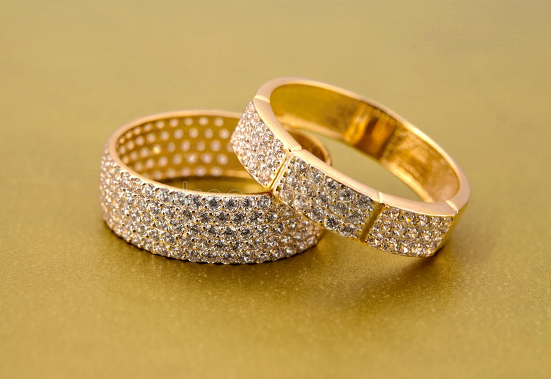 Golden jewelry two rings stock photos