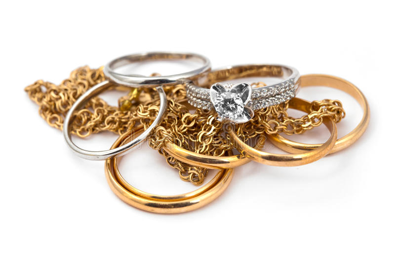Golden jewelry on white. Golden jewelry accessories with brilliants on white background stock photography