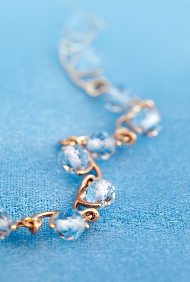 Jewelry bracelet with blue topaz stock photos