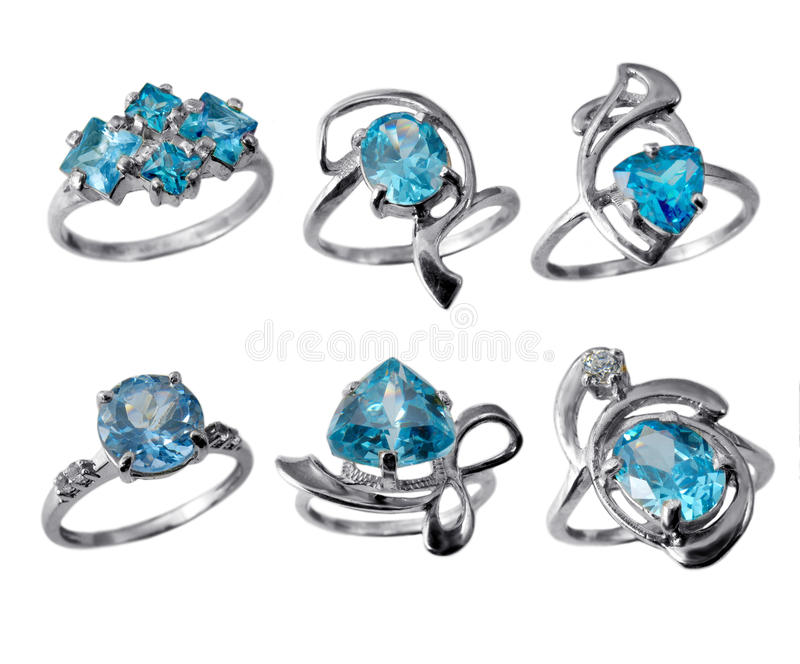 Golden jewelry rings with blue topaz