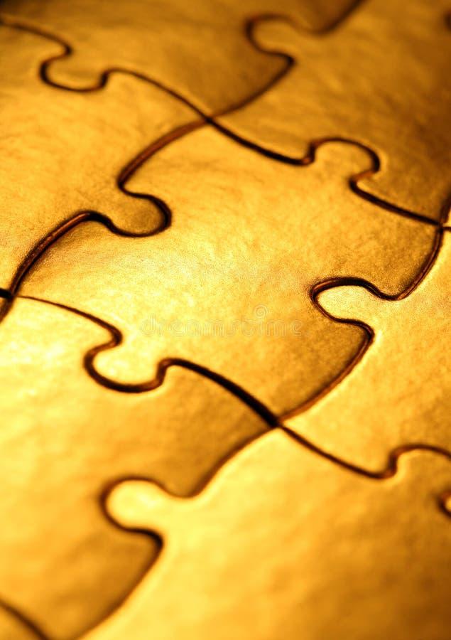 Golden jigsaw royalty free stock photos